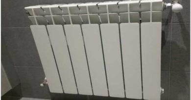 Radiadores a baja temperatura de la mano con el ambiente